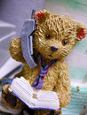Teddy bear on phone Stock Photos