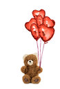 Teddy bear with red heart shaped balloons.