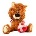 Teddy bear with red heart on white sad broken Stock Photo