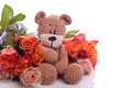 Teddy bear with red roses brown Royalty Free Stock Images