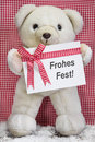 Teddy bear with a red and white checkered greeting card for chri christmas coupon or present christmas in country style Stock Photography