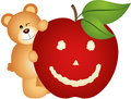 Teddy bear with smiling apple Royalty Free Stock Photo