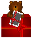 Teddy bear with tablet in the gift box cute jumping out from a Royalty Free Stock Image