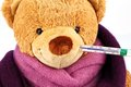 Teddy bear with thermometer Stock Images