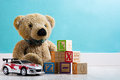 Teddy bear and toys in a baby`s room Royalty Free Stock Photo