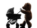 Teddy bear walking prams baby silhouette one on white background Royalty Free Stock Photo
