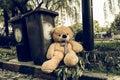 The teddy-bear was throw away sitting beyside the garbage trash Royalty Free Stock Photo