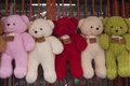 Teddy bears in different colors on display Stock Photo