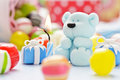 Teddy with candle and candy little sugar sweets Stock Photo