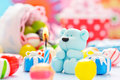 Teddy with candle and candy small sugar candles Royalty Free Stock Images