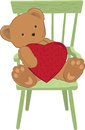 Teddy Holding Heart Stock Image