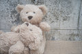 Teddybears relaxing on a bench Royalty Free Stock Photo
