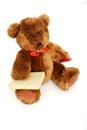 Teddybeer met post-it en potlood Stock Foto