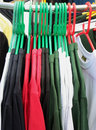 Tee-shirts on Hangers Stock Photos