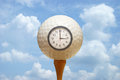 Tee time a golf ball and clock remind the golfer of their off Stock Photos