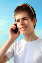 Teen with Apple iPhone  Stock Photography