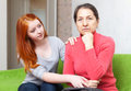 Teen asks for forgiveness from her mother Stock Image
