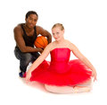 Teen ballerina an basketball player boyfriend a teenage in red tutu with her Stock Image