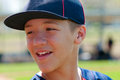 Teen baseball boy up close player and smiling Royalty Free Stock Images