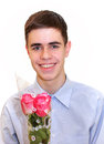 Teen Boy with Bouquet of Roses Royalty Free Stock Images