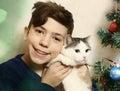 Teen boy with cat hugging