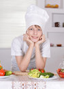 Teen boy in chefs hat Royalty Free Stock Photo