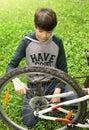 Teen boy close up photo repair bicycle tire