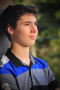 Teen boy daydreaming a closeup view of a typical with dark hair in deep thought shallow depth of field Royalty Free Stock Photos