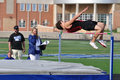 Teen Boy Doing the High Jump at Track Meet Stock Image