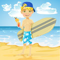 Teen boy with a drink in a glass and a surfboard o cute on sunny beach Stock Photo