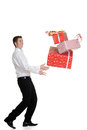 Teen boy dropping christmas presents on white background Royalty Free Stock Image