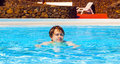 Teen boy enjoys swimming in a pool cute Royalty Free Stock Image