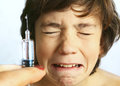 Teen boy in fear of injection. Royalty Free Stock Photo