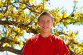 Teen boy happy and smiling teenage up in the tree Royalty Free Stock Photos