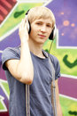 Teen boy with headphones Stock Photos