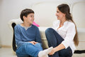 Teen boy with his young mother at home Royalty Free Stock Photo
