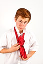 Teen boy knots his tie red Stock Images