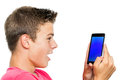 Teen boy looking at smart phone surprised portrait of holding with face expression isolated on white background Royalty Free Stock Photography