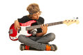 Teen boy playing bass quitar sitting on floor with legs crossed and guitar isolated on white background Stock Photo