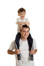 Teen boy and preschooler preschool aged riding on s shoulders isolated on white background Royalty Free Stock Image