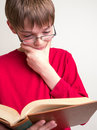 Teen Boy Reading a Book Stock Photo