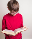 Teen Boy Reading Book Royalty Free Stock Images