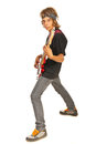 Teen boy rocker with bass guitar playing isolated on white background Royalty Free Stock Images