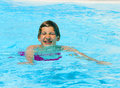 Teen boy swimming in the pool cute Royalty Free Stock Photo