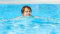 Teen boy swimming in the pool cute Royalty Free Stock Image