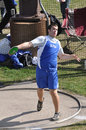 Teen Boy Throwing Discus at High School Track Meet Stock Image