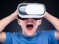 Teen boy in VR glasses