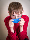 Teen Boy Watch Movie on Cell Phone Royalty Free Stock Photo