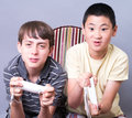 Teen Boys Playing Video Games Royalty Free Stock Images