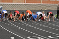 Teen Boys in Starting Blocks at Sprint Race Stock Photo